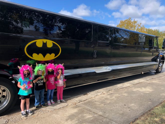 East Elementary PTO recently concluded their Big Kahuna fundraiser, and on Thursday, November 5, students who sold 15 items or families that sold 20 items received the prize of a hat and a ride on the Big Kahuna Party Bus. During the day each of the winners took their turn riding on the eye-catching black bus with a Batman theme. Additional photos including more of the winners enjoying their rides on the bus can be found at https://www.brownwoodisd.org/eastBK