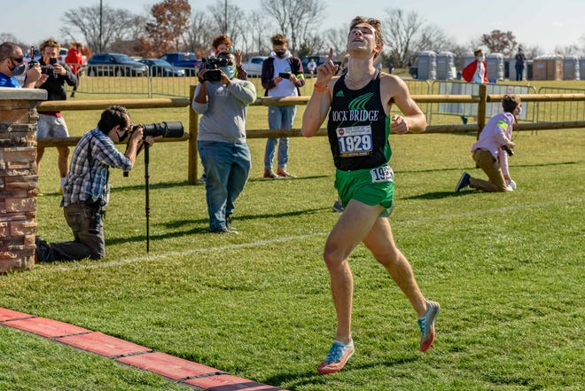 Rock Bridge's Matthew Hauser points to the sky as he crosses the finish line to win the Class 5 boys state title Saturday at Gans Creek Recreation Area.