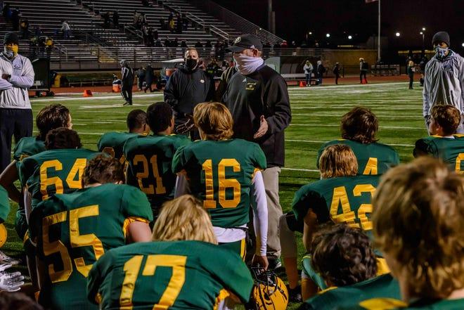 Rock Bridge head football coach Van Vanatta speaks to his team following its district quarterfinal game Oct. 30 at Rock Bridge High School.