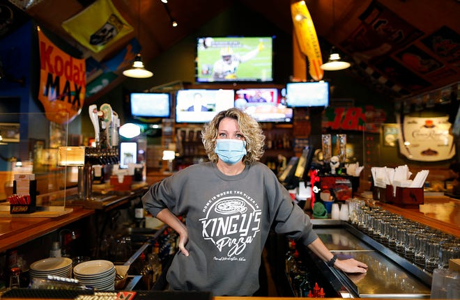 Carrie Ahlers, who has worked at Kingy's Pizza in Canal Winchester for 26 years, said regular customers have kept the restaurant going during the pandemic but washing down counters and other fixtures has been nonstop.
