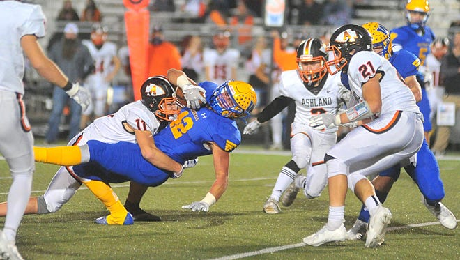 Ashland's Braylen Hider tackles Wooster's Joey Lyons during the Arrows' 46-35 win Friday night at Follis Field.