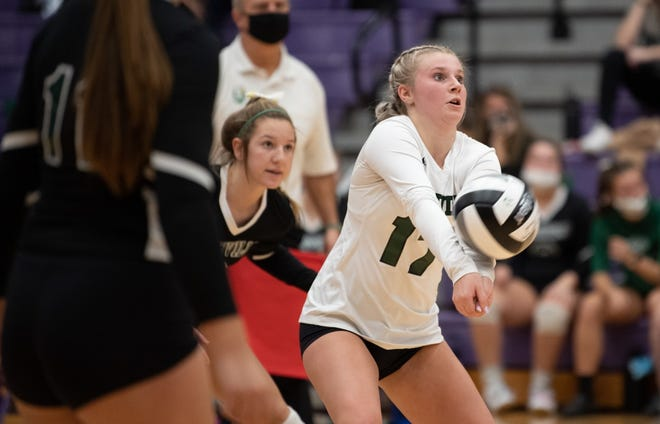 Smithville's Kiley Kalina returns a shot during the match against Independence.
