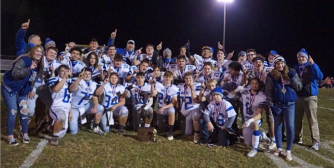The Reynolds footalll team celebrates its District 10 Class 1A championship Friday, Nov. 6, 2020, after beating Eisenhower 27-0 in Russell.