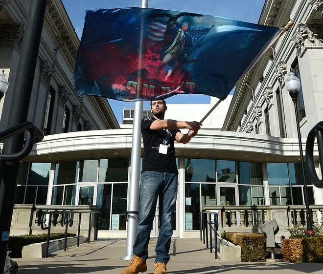 """Justin Wilson of Lincolnville attends an """"I Love America, Protect Our Ballots"""" protest outside the Erie County Courthouse in November. Another protest of the presidential election results is scheduled for Wednesday."""