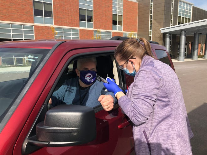 Aimee Smith, St. James Hospital Emergency Department nurse manager, takes Spectator city editor Neal Simon's blood pressure during a drive-through blood pressure screening clinic Nov. 5 at the hospital.