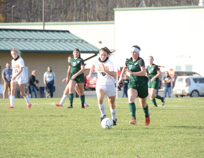 Wellsville senior Carley Young pushes the pace as Genesee Valley's Grace Darrin pursues Saturday afternoon.