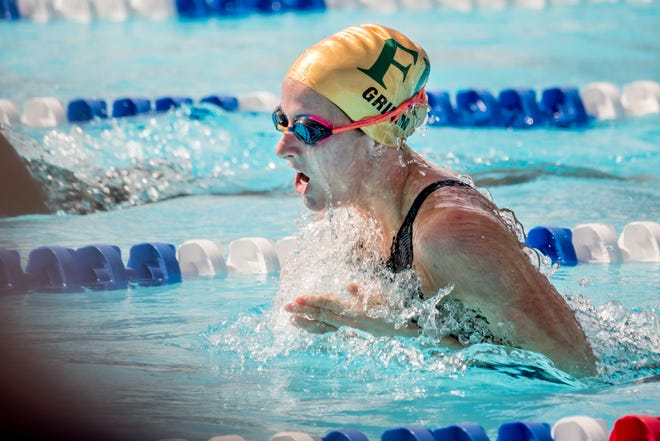 Fleming Island's Emma Grimm competes in the 100-yard breaststroke during the FHSAA Swimming and Diving State Championships on Friday. The senior helped the Golden Eagles to second place overall, including a medley relay championship.
