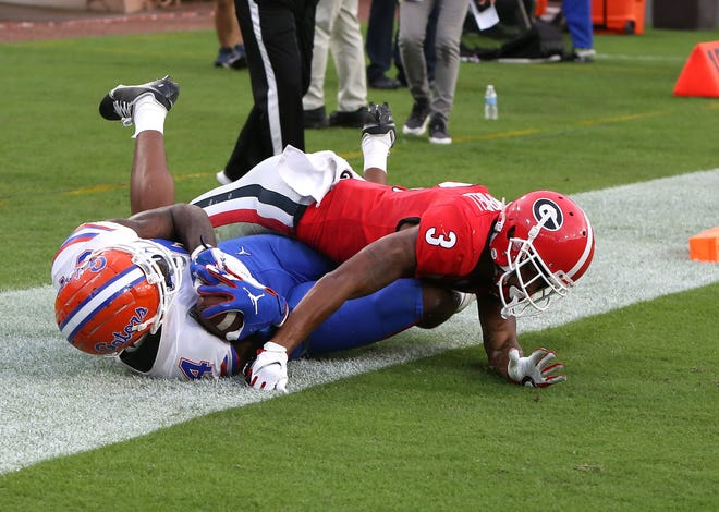 Florida tight end Kyle Pitts (84) makes a touchdown catch Saturday against Georgia at TIAA Bank Field in Jacksonville.