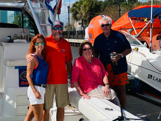 Two sets of married couples have been coming to the Georgia-Florida game on their boats for nearly 20 years. From the left are April and Steve Conrad of Daytona Beach and Donna and Bill Bucholtz of Orlando.