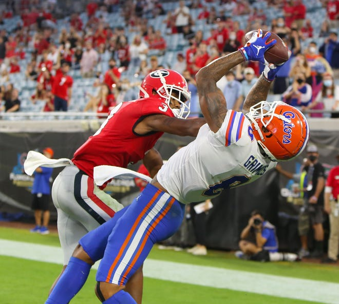 Florida receiver Trevon Grimes (8) reaches back to make a touchdown catch during the final moments of the first half against Georgia on Saturday, at TIAA Bank Field. Brad McClenny/The Gainesville Sun]