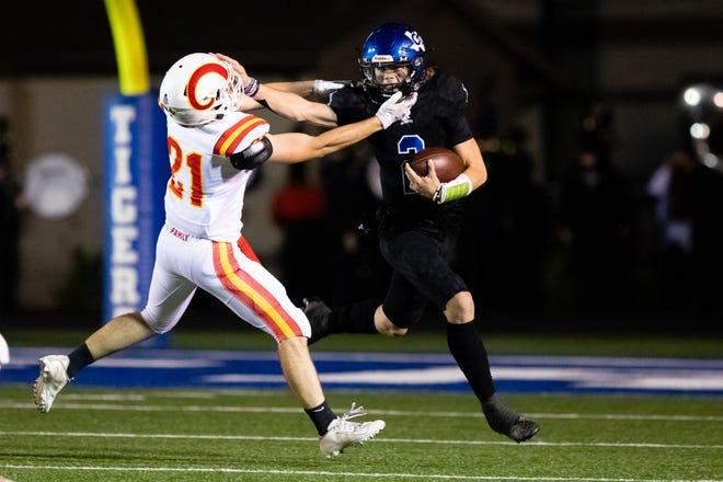 Gunter's Hudson Graham stiff-arms S&S' Gage Moore during the Tigers' victory over the Rams in District 8-3A (II) play.