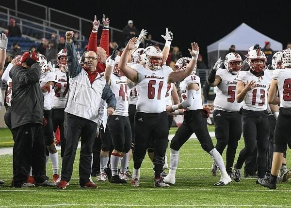Cincinnati La Salle coach Pat McLaughlin, left, and the Lancers celebrate a touchdown during the 2019 Division II state championship game against Massillon.  (IndeOnline.com / Kevin Whitlock)