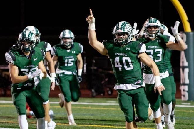 Pennridge linebacker Shane Hartzell (40) celebrates after sacking Coatesville quarterback Harrison Susi in the end zone for a safety during a District One Class 6A semifinal game on Friday, November 6, 2020. Pennridge won, 36-33.