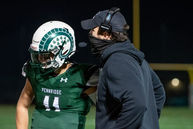 Pennridge senior quarterback Bobby Croyle receives instructions from head coach Cody Muller. Croyle threw for 298 yards and two touchdowns in last week's PIAA District One Class 6A semifinal win over Coatesville.