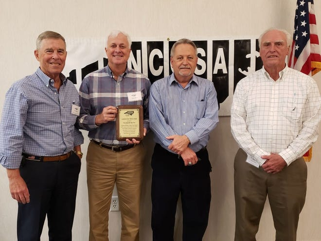 """From left to right - Onslow Crime Stoppers Chairman Joe Yannessa, CS Board Member Wayne Mixon, NCCSA President Charles Cobb and Bob Bright displaying the """"Outstanding Media Award"""" given to The Daily News in recognition of most supportive media source to a Crime Stoppers agency in the state."""