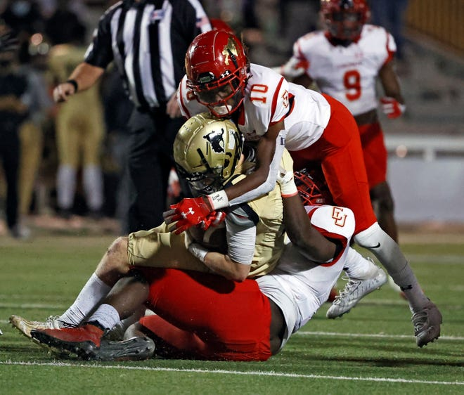 Coronado's CJ Lewis (93) and Izaiah Kelley (10) tackle Lubbock High's Brandon Smith (11) during a District 2-5A, Division I game, Friday, Nov. 6, 2020, at PlainsCapital Park at Lowrey Field.
