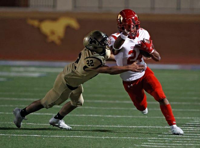 Lubbock High's Juan Palomo (22) tackles Coronado's Antonio Malone (24) during a District 2-5A, Division I game, Friday, Nov. 6, 2020, at PlainsCapital Park at Lowrey Field.