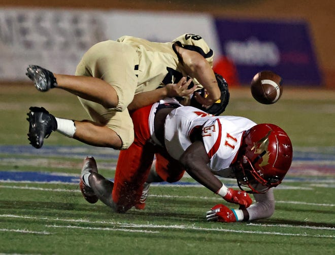 Coronado's Ted Gilmore (11) forces a fumble while tackling Lubbock High's Benny Soto (28) during a District 2-5A, Division I game Nov. 6 at PlainsCapital Park at Lowrey Field.