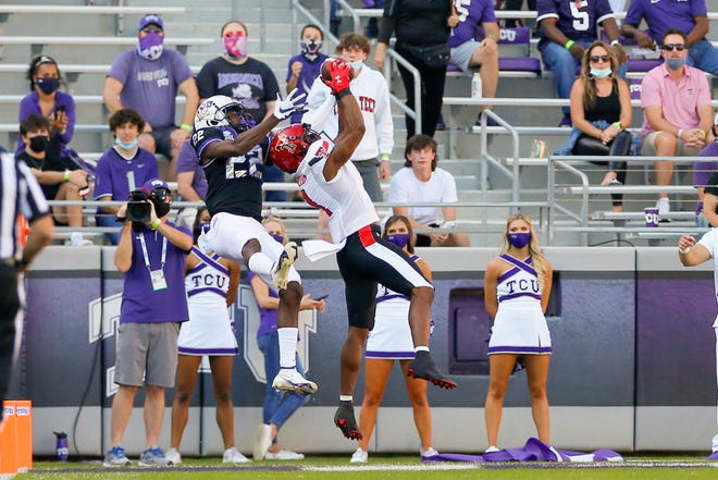 Texas Tech cornerback Zech McPhearson intercepts a pass into the end zone for TCU wide receiver Blair Conwright. The play came on TCU's first offensive snap in the Horned Frogs' 34-18 victory Saturday at Amon Carter Stadium in Fort Worth.