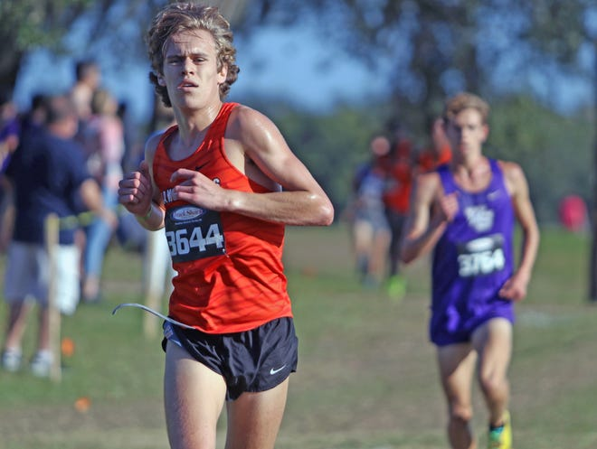 Lake Wales senior Mac Updike leads the race at the 2-mile mark and went on to finish second on Saturday morning in the Class 3A, Region 2 boys cross country meet at Lake Region High School.