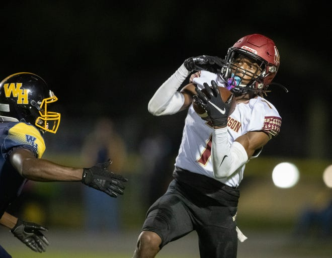 Lake Gibson's Cormani McClain hauls in a pass for a touchdown as Winter Haven's Chaise White tries to defend in the first half on Friday night at Denison Stadium in Winter Haven.