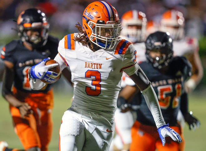 Bartow reciever Daithon Davis races away from Lake Wales defenders to score.