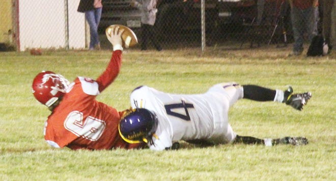 Fowler High School's Antonio Aragon (4) sacks Crowley County's Tach Brewer (6) in Friday's game in Ordway. Fowler defeated Crowley County, 32-22.