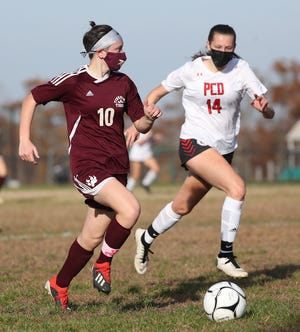 Tiverton freshman Maeve Banal (10) has a step on Providence Country Day defender Jennifer Sturges down the field on Saturday afternoon.