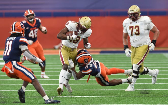 Boston College wide receiver Jehlani Galloway (13) is tackled by Syracuse defensive back Ifeatu Melifonwu (2) during the first half Saturday at the Carrier Dome. Boston College edged Syracuse 16-13 in the ACC game.