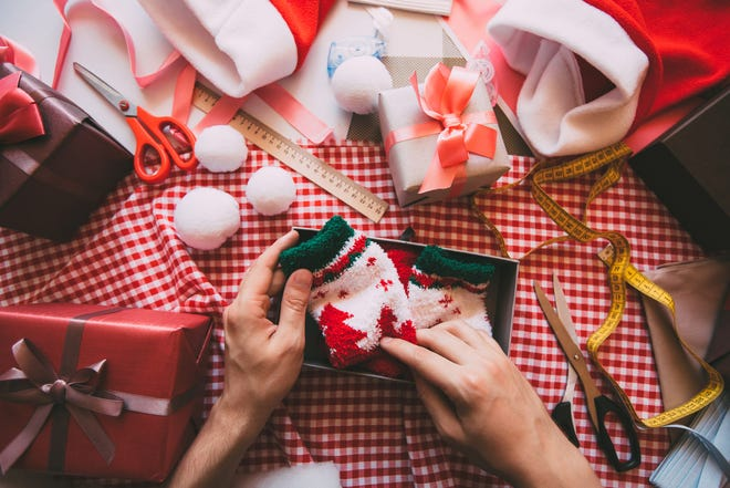 Wrap Christmas presents as soon as you purchase them to keep from being stressed later on.
