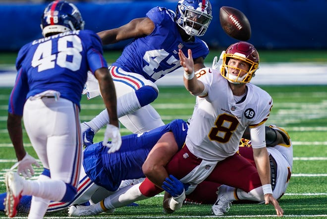Washington quarterback Kyle Allen (8) loses control of the ball during a game Oct. 18 in East Rutherford, N.J. A few weeks after a missed opportunity of a 20-19 loss at New York, Washington (2-5) can still move within a half-game of idle, first-place Philadelphia by evening the season series with the Giants.