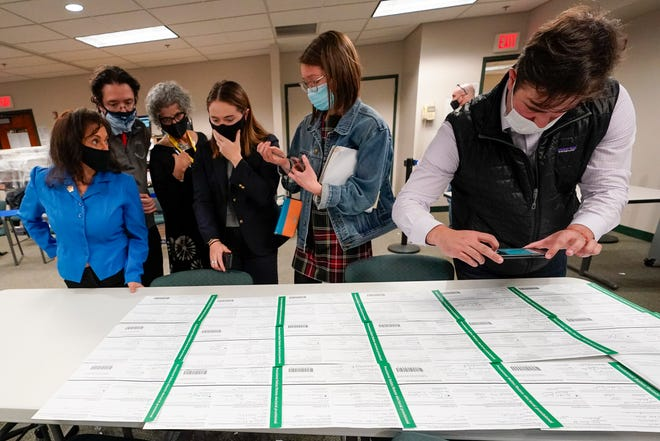 Democratic and Republican canvas observers inspect Lehigh County provisional ballots as vote counting in the general election continues, Friday, Nov. 6, 2020, in Allentown, Pa. (AP Photo/Mary Altaffer)