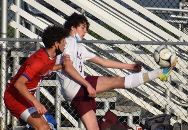 Clinton's Dillon Matteson stretches out to kick keep the ball from New Hartford's Nick Linder on Saturday afternoon at Don Edick Field. New Hartford. Lindor had a goal in New Hartford's 3-1 victory on Saturday.