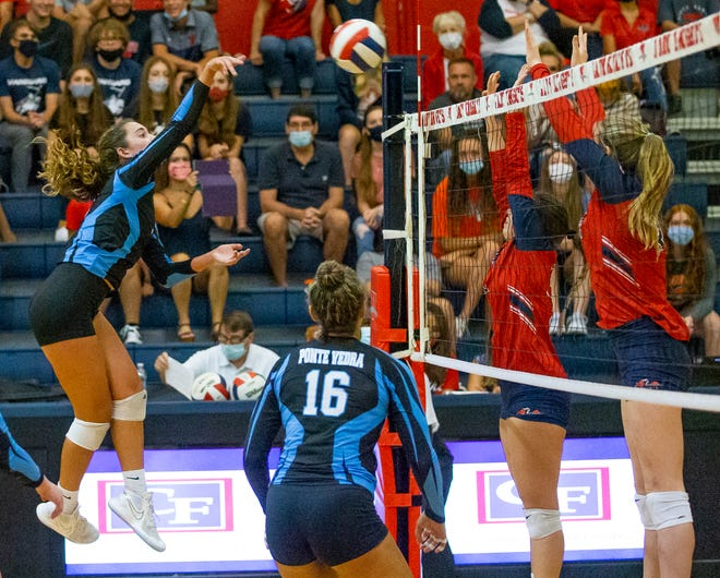 Ponte Vedra's Kendall Mignerey (7) spikes one over the net in the third set of the Class 5A state semifinal against Ocala Vanguard.