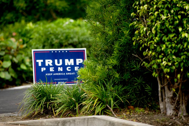 A campaign sign endorsing President Donald Trump and Vice President Mike Pence remained on the lawn Saturday at a home near North Lake Way.