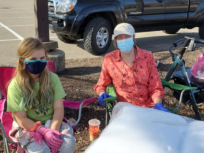 Dover residents Jane Mathews, 10, and Barb Nadeau are ready to help serve lunch to homeless guests on Saturday. The event takes place each week in the parking lot of the Dover Transportation Center.