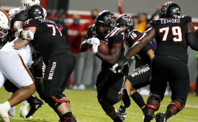 N.C. State running back Zonovan 'Bam' Knight (7) scores on a one-yard touchdown run without his shoe against Miami during their Nov. 6 meeting at Carter-Finley Stadium in Raleigh.