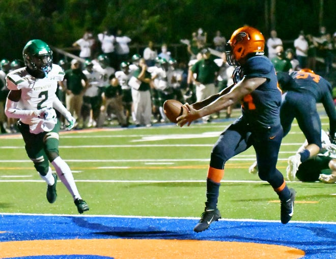 Benjamin running back Khani Johns burst into the end zone for the tying score in the second quarter of Friday's win-or-go-home matchup against Westminster.