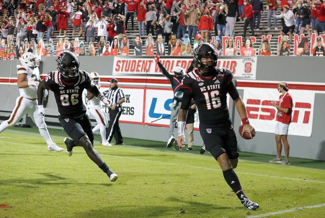 N.C. State quarterback Bailey Hockman (16) celebrates after scoring on a 31-yard touchdown reception during the first half of N.C. State's game against Miami at Carter-Finley Stadium in Raleigh, N.C., Friday, Nov. 6, 2020.