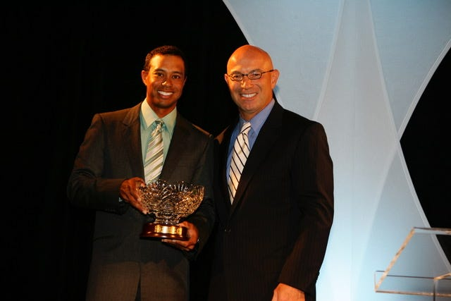 Tiger Woods and Tim Rosaforte shown during the Golf Writer's Association of America awards dinner prior to the Masters on April 4, 2007. Golf Writers Association of America