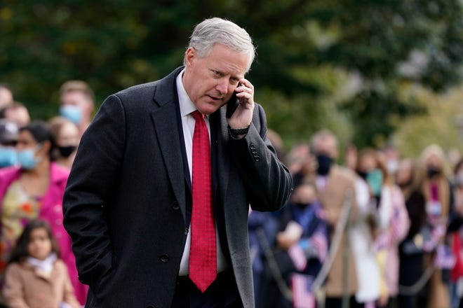 White House chief of staff Mark Meadows speaks on a phone on the South Lawn of the White House on Oct. 30. Meadows has been diagnosed with COVID-19, according to two Trump administration officials.