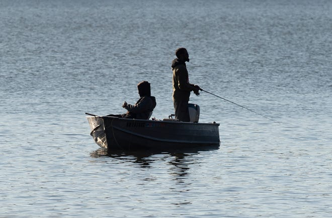 Two people fish in a boat on Wingfoot Lake in Suffield.