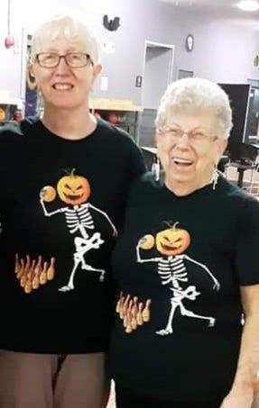 White's Senior Doubles league members Corky Farquhar, on the left, and Patti Andrews in Halloween costume.