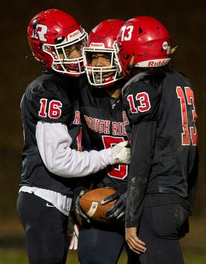 """Kent Roosevelt hosted the rivalry game with Ravenna and left with the """"R""""  37-7.  Raheem Howard (center) celebrates his touchdown with Ty Bates and Donovan Daetwyler."""