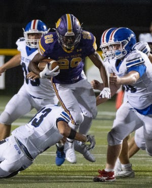 Jackson's Brenden Craig — picking up yardage against Lake on Sept. 4, 2020 — put together a record-setting night Friday in his team's rout of Nordonia to end the 2020 season.