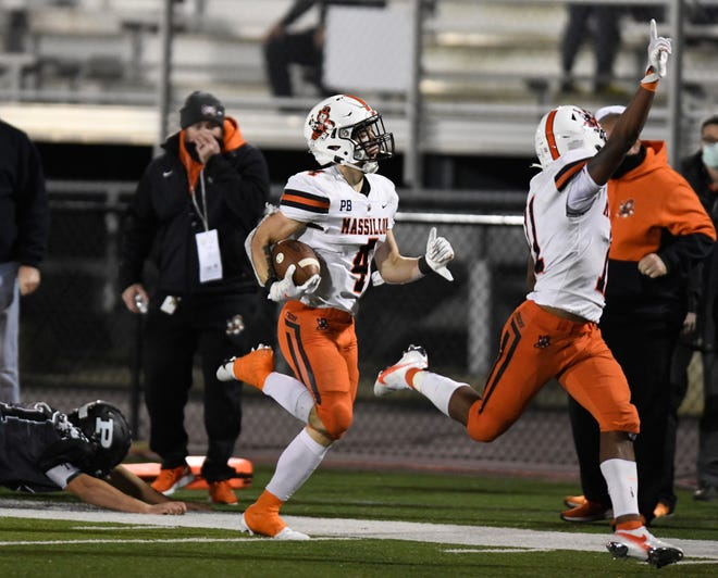 Massillon's Austin Brawley returns a punt for a touchdown as teammate Martavien Johnson celebrates during the second half of last Friday's Division II, Region 7 championship win over Perry.  (IndeOnline.com / Kevin Whitlock)