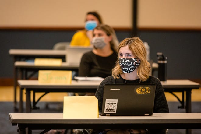 Students at Kent State University at Stark listen during a class. Kent State Stark saw its enrollment remain flat this fall despite the coronavirus pandemic.