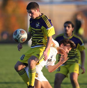 Anthony Morgan of Jackson fights to control the ball while being defended by Brayden Gotsky of Saint Ignatius during their DI regional final at Jackson on Saturday, Nov. 7, 2020. 
