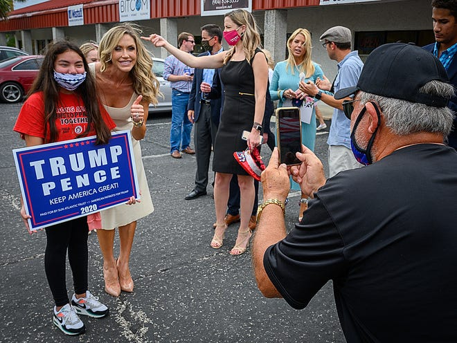 Lara Trump, wife of Eric Trump, poses for a photograph with a supporter during a campaign stop for President Trump at the St. Johns County Republican Party Headquarters in St. Augustine in September.