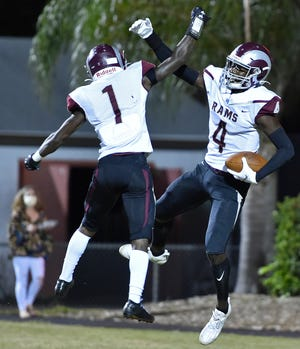 Riverview High's Jaron Glover (4) celebrates a 25-yard touchdown pass with teammate Omari Hayes (10) during Friday night's game against Sarasota High at Ihrig Field at Cleland Stadium in Sarasota.